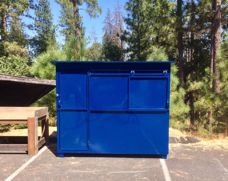Custom designed and fabricated metal recycle bin.
